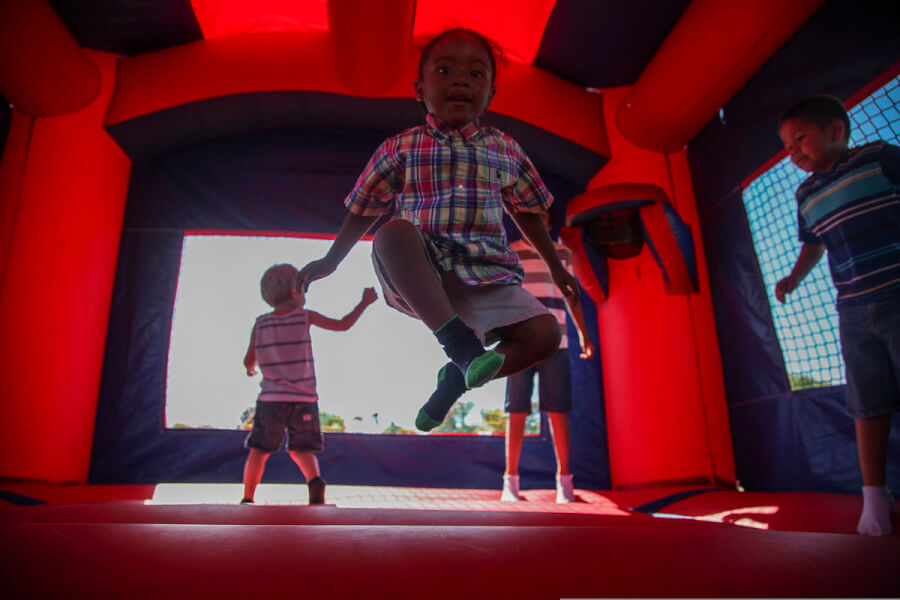 Kids bouncing on a inflatable