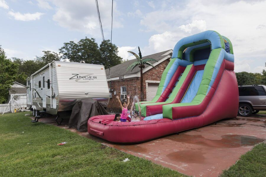 inflatable water slide outside a home in Dallas Texas